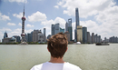 Caucasian man looking at Shanghai Skyline