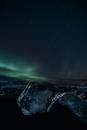 Northern lights over icy night landscape and Jokulsarlon glacier, Iceland