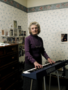 Senior woman playing keyboard
