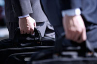 Close-up of businessmen well-dressed holding briefcase 11010043807| 写真素材・ストックフォト・画像・イラスト素材|アマナイメージズ