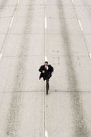 Looking down to a businessman running down a road 11015195036| 写真素材・ストックフォト・画像・イラスト素材|アマナイメージズ