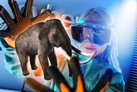 Girl in virtual reality headset interacting with digital floating elephant 11015303378| 写真素材・ストックフォト・画像・イラスト素材|アマナイメージズ