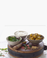 Selection of noodles, curried fish and herbs in bowls 11015324761| 写真素材・ストックフォト・画像・イラスト素材|アマナイメージズ