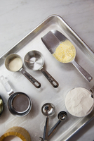 Overhead view of raw pastry baking ingredients with scoop and measuring spoons 11015325199| 写真素材・ストックフォト・画像・イラスト素材|アマナイメージズ