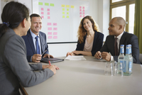 Smiling business people planning in meeting at board room 11016034292| 写真素材・ストックフォト・画像・イラスト素材|アマナイメージズ