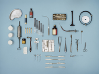 Directly above shot of medical tools on blue background 11016035465| 写真素材・ストックフォト・画像・イラスト素材|アマナイメージズ