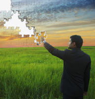 Indian businessman putting piece in jigsaw puzzle sky 11018074336| 写真素材・ストックフォト・画像・イラスト素材|アマナイメージズ