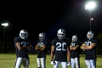 Football players in uniform with arms crossed 11018077767| 写真素材・ストックフォト・画像・イラスト素材|アマナイメージズ