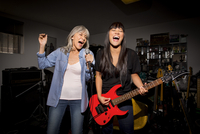 Mother and daughter playing music guitar in basement 11018087038| 写真素材・ストックフォト・画像・イラスト素材|アマナイメージズ