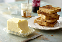 Stack of Whole Wheat Toast on Plate with Block of Butter and Jam on Tabletop 11030048619| 写真素材・ストックフォト・画像・イラスト素材|アマナイメージズ