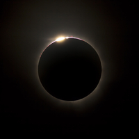 Solar Eclipse with prominences and diamond ring effect. 11079024976| 写真素材・ストックフォト・画像・イラスト素材|アマナイメージズ