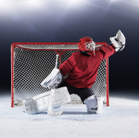 Hockey goalie in red uniform reaching for puck with glove at goal net 11086028003| 写真素材・ストックフォト・画像・イラスト素材|アマナイメージズ