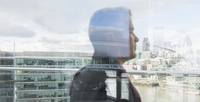 Pensive businessman looking at urban city view from balcony, London, UK 11086033897| 写真素材・ストックフォト・画像・イラスト素材|アマナイメージズ