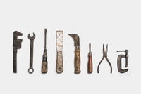 Used tools arranged in a row. Metal rusty and marked implements.  11093002339| 写真素材・ストックフォト・画像・イラスト素材|アマナイメージズ