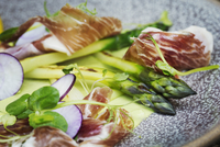 Close up high angle view of green asparagus and ham on a plate. A restaurant dish. 11093016839| 写真素材・ストックフォト・画像・イラスト素材|アマナイメージズ