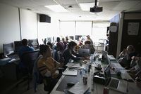 Hackers working hackathon at laptops and computers in dark office 11096047722| 写真素材・ストックフォト・画像・イラスト素材|アマナイメージズ