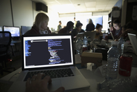 Personal perspective hacker coding on laptop at hackathon in dark office 11096047747| 写真素材・ストックフォト・画像・イラスト素材|アマナイメージズ