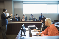 Male prosecutor attorney talking to jury and pointing at defendant in legal trial courtroom 11096050485| 写真素材・ストックフォト・画像・イラスト素材|アマナイメージズ