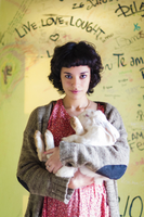 Portrait of young woman with rabbit, Patagonia, Chile 11098059188| 写真素材・ストックフォト・画像・イラスト素材|アマナイメージズ