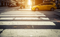 Focus on pedestrian lines in New york, with yellow cab in the ba 11098078403| 写真素材・ストックフォト・画像・イラスト素材|アマナイメージズ