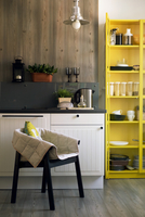 Chair and yellow cabinet in domestic kitchen 11100033883| 写真素材・ストックフォト・画像・イラスト素材|アマナイメージズ