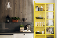 Yellow cabinet by kitchen counter at home 11100033884| 写真素材・ストックフォト・画像・イラスト素材|アマナイメージズ