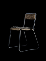 Chair with nails on black background 11107001906| 写真素材・ストックフォト・画像・イラスト素材|アマナイメージズ